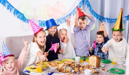 Happy group children having party friend's birthday