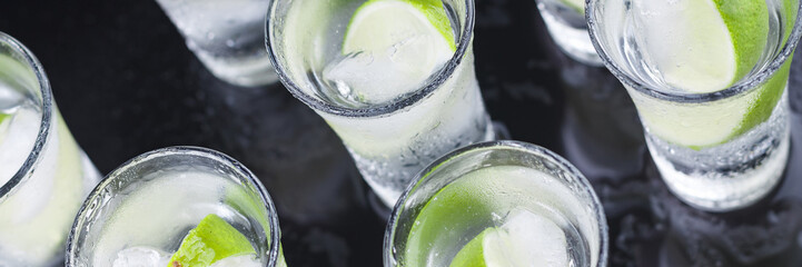 Cocktail. Vodka, gin, tequila with lime