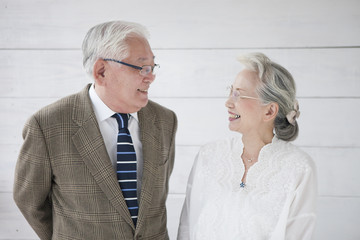 An old couple staring at each other with a smile