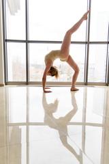 Girl gymnast near the window.