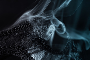 carnival mask in smoke