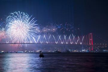 Fireworks over Istanbul Bosphorus during Turkish Republic Day celebrations. 15th July Martyrs Bridge (15 Temmuz Sehitler Koprusu). Istanbul, Turkey..