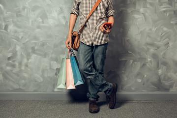 Young asian man hold shopping bag