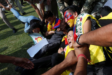 Tibetan exiles are detained by police during a protest outside Chinese embassy in New Delhi