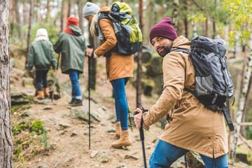 man trekking with family