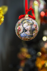 Christmas decorations on the branches fir. New Year's ball with a print of the Renaissance picture