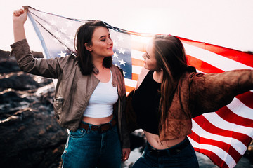 Teenage girls holding USA flag