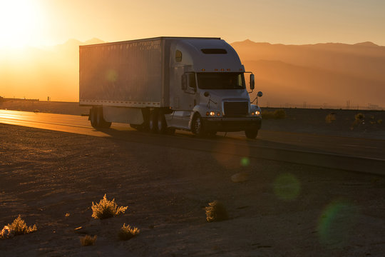 American style truck on freeway pulling load. Transportation theme