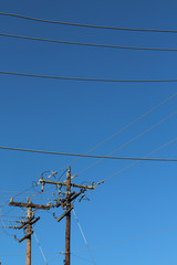 Horizontal power lines and vertical power poles background