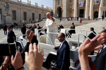 Pope Francis waves at the end of his Wednesday general audience in Saint Peter's square at the Vatican