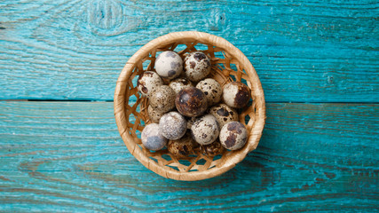Photo of quail eggs in straw basket