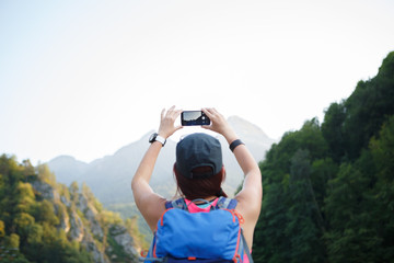 Image from back of brunette tourist with backpack