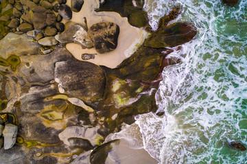 Wall Mural - Sea waves hitting rocks of a beach on Lofoten islands in Norway