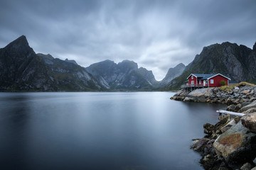 Wall Mural - Traditional red rorbu cottage in Hamnoy village, Lofoten islands, Norway