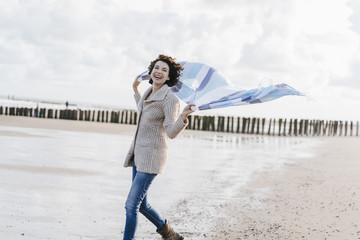 Happy woman with cloth on the beach