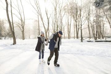 Senior couple ice skating
