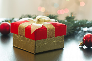 Christmas gift or New Year with decorations on table on bokeh background