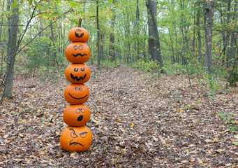 Stack of pumpkins in the woods