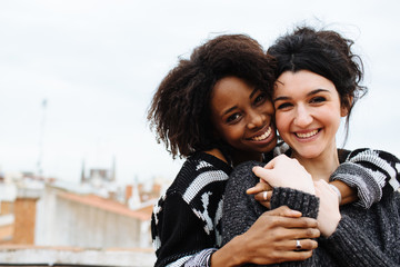 Portrait of two beautiful affectionate female friends