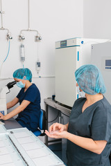 Biologists Working in an Assisted Reproduction Laboratory