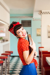Portrait of smiling waitress in vintage outfit.