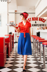 Pin up rockabilly waitress woeking in diner restaurant.