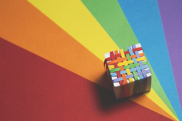 Colourful Cube on Rainbow Background