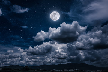Night sky with bright full moon and dark cloud, serenity nature background.