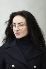 young woman with round glasses
