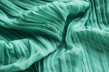The texture of the mint pleated fabric. Green georgette fabrics.