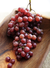 Red grapes in wood bowl