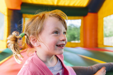 Young girl inside a Bouncy House