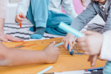 Children drawing during art classes