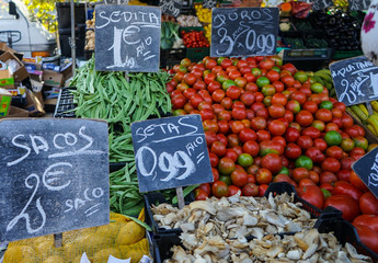 Mushroom, tomatoes, green beans, potatoes sack in a vegetables stand in a street market in Madrid, Spain.