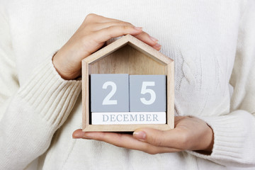 December 25 in the calendar. the girl is holding a wooden calendar. Boxing Day, St. Stephen's Day