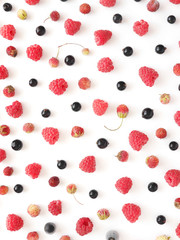 Fresh berries pattern. Composition of raspberry, currant and strawberry on a white background. Top view, flat lay. Food background. Food wallpaper.