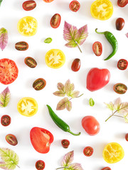 Food collage of fresh vegetables, top view. Tomatoes in a cut, pepper, autumn leaves isolated on white background. Abstract composition of vegetables. Сoncept of healthy eating, flat lay.
