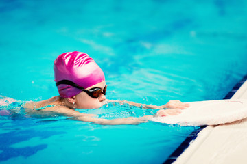 Little girl in swimming training