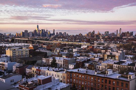 Lower Manhattan skyline over Brooklyn apartment rooftops