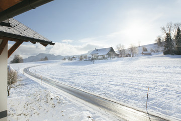 Street in winter landscape in austria