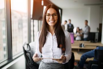 Portrait of beautiful businesswoman holding digital tablet