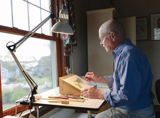 Senior Artist Working in His Studio at home