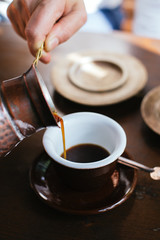 Drinking Turkish coffee