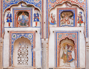 Naive fresco with indian lord Krishna and Garuda on historical house wall of Rajasthan