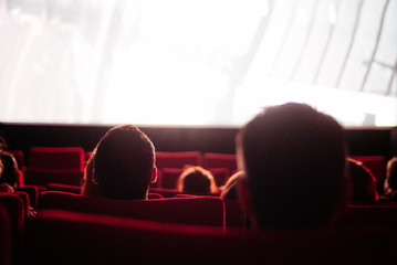 People watching a movie in cinema