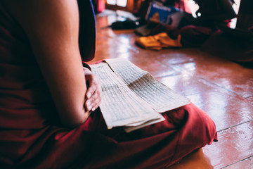 Monk reading Sutras in Lingshed monastery