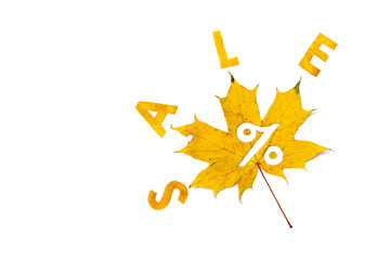 Autumn discounts. Letters are cut from wedge leaves
