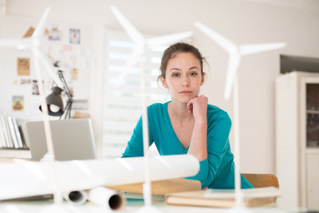 woman architect working on an ecological construction project