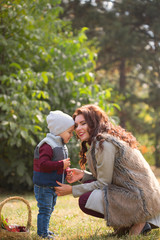 mother with her son walks in the autumn park