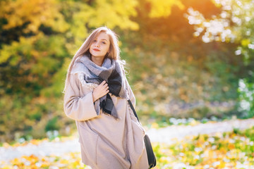 happy smiling woman, outdoors, autumn park.